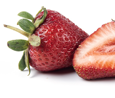 Red Fresh Strawberries with Green Leaves
